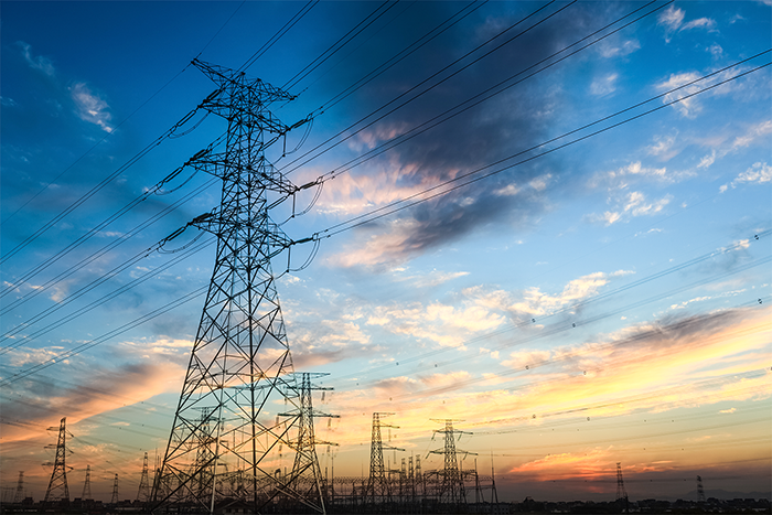 0011_power-transmission-tower-at-dusk-PKGTTPV